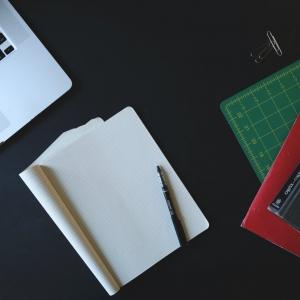 book and laptop - Tara Transform